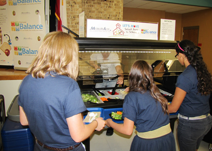 Students at Jackson Middle School—North East Independent School District select fresh veggies from the new salad bar at their cafeteria. Photo courtesy of Communities Putting Prevention to Work.
