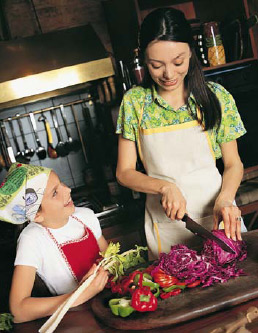 Parent and Child Cutting Vegetables