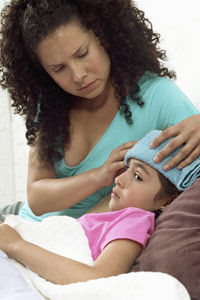 Mother taking care of a sick child