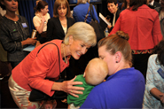 HHS Secretary Sebelius with Robyn M. and her son, Jax, at a Women's Health Town Hall event at the White House. Credit: Photo by HHS/Michael Wilker.