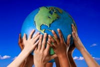 Many hands on the globe