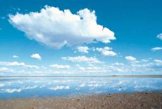 Photograph of clouds in the sky over a body of water