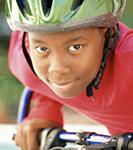 Photo: boy riding bike with helmet