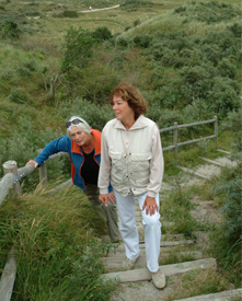Copyrighted photo of two elderly women walking up an outdoor staircase.
