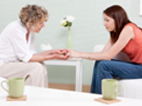 Photo of two women advising each other in a depression treatment center.