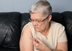 image of woman injecting insulin into her arm