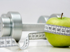 image of  green apple, free weight, and tape measure