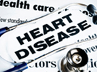 image of stethoscope with newsprint: 'heart disease'