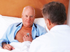 image of doctor talking to an elderly man in bed
