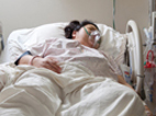 image of woman in a hospital bed on a mechanical ventilator