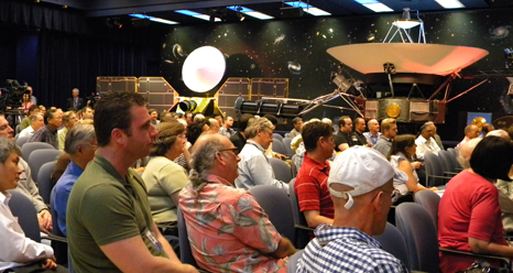 As part of a celebration of 35 years of flight for NASA's Voyager spacecraft, a crowd of engineers and scientists at NASA's Jet Propulsion Laboratory
