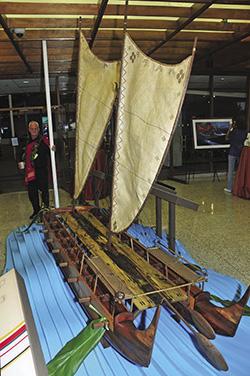 Tay Perry with Hokulea canoe