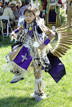 A young traditional dancer performs