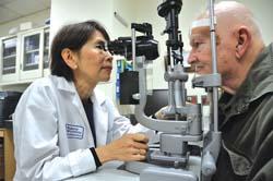 Dr. Emily Chew conducting an eye exam