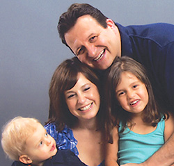 Jay Hobby with his wife and two children
