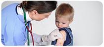 A boy gets a flu shot.