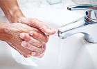 A person washing their hands