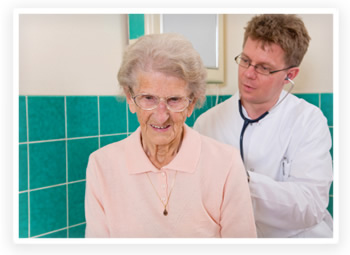 An elderly patient gets a check-up from her doctor
