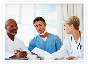 Doctors and specialists review charts together