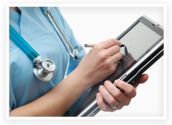A nurse uses a tablet laptop to record patient information