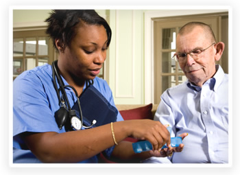 A home health care worker goes over medications with her senior patient