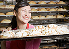 Woman behind bakery counter