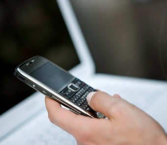 Image of cell phone and laptop
