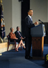 a photo of President Obama speaking at a podium, with Secretary Sebelius and Dr. Collins seated in the background.