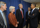 a photo of President Obama, Secretary Sebelius, Dr. Collins, Deputy Secretary Corr, and Dr. Holdren talking in a group.