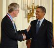 President Barack Obama and NIH Director Francis Collins shaking hands.