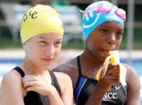 Girls on swim team eat bananas