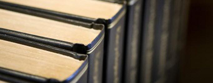 Bound scientific journals on a bookshelf