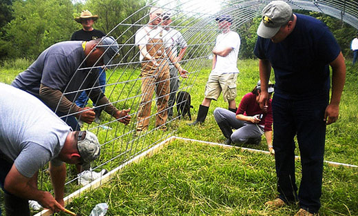 Military veterans-turned-beginning-farmers learn how to build mobile poultry units at an Armed to Farm workshop at the University of Arkansas in Fayetteville, AR.