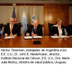 Photo depicting from left to right, Minister Jose Luiz Perez Gabilondo, Deputy Chief of Mission, Argentine Embassy, John E. Niederhuber, M.D., Director, National Cancer Institute, U.S., and Maria Julia Munoz, M.D., Minister of Health, Uruguay
