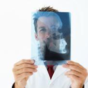 Health care professional looks at X-ray