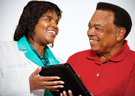 Dr. Karen Smith and her patient, Donald Jones, use electronic health records to help manage his diabetes.