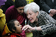 HHS Secretary Sebelius administers polio vaccine to a child in India. Credit: Photo by Rakesh Malhotra.
