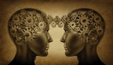 Two heads showing brains as gears that are interconnected through space