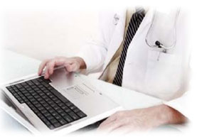 Doctor at keyboard