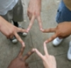 5 people using their fingers to form a star