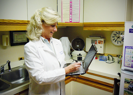 """Sherri Stuart at work in her new job. """"This new job is absolutely a new direction for me, and a new chapter in my life,"""" Stuart said. Photo courtesy of Sherri Stuart."""