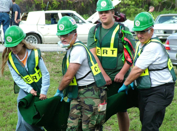 CERT volunteers carrying an injured victim