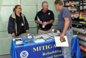 Hazard Mitigation Specialists sharing information in damaged counties to instruct rebuilders about safer rebuilding techniques.