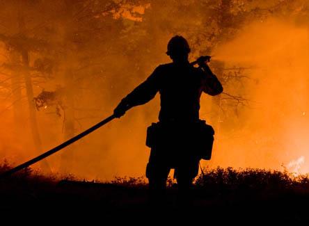 Photo of firefighter extinguishing blaze