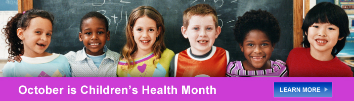 Childen standing in front of chalkboard - October is Children's Health Month