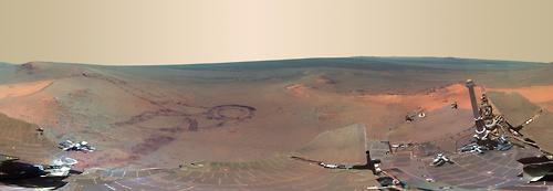 Image description: This full-circle photo of Mars' surface is made of 817 images taken by the panoramic camera on NASA's Mars Exploration Rover Opportunity. It shows the terrain that surrounded the rover while it was stationary for four months of work during its most recent Martian winter. Learn more about the Martian features in the photo. The explorer Opportunity and its twin, Spirit, landed on Mars in January 2004. NASA's next-generation Mars rover, Curiosity, landed on Mars in August. Image from NASA/JPL-Caltech/Cornell/Arizona State University