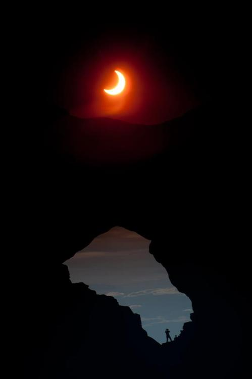 Image description: A picture of the solar eclipse that happened over the weekend taken at Arches National Parkin Utah. Photo from the National Park Service.
