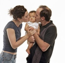 Two parents hold a child