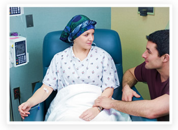 A cancer patient receives treatment from her doctor