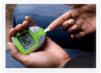 A diabetic woman tests her blood sugar levels
